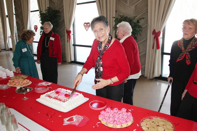 Judy Henn slicing up our Valentine Tea cake